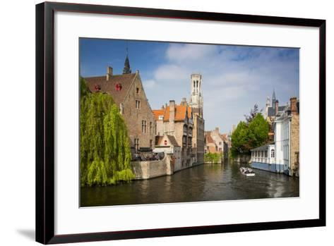 Tourist on Boat Ride Through the Canals of Bruges, Belgium-Brian Jannsen-Framed Art Print