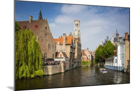 Tourist on Boat Ride Through the Canals of Bruges, Belgium-Brian Jannsen-Mounted Photographic Print