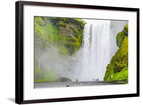 Iceland. South. Skogafoss. Hikers are Skogafoss Waterfall-Inger Hogstrom-Framed Art Print