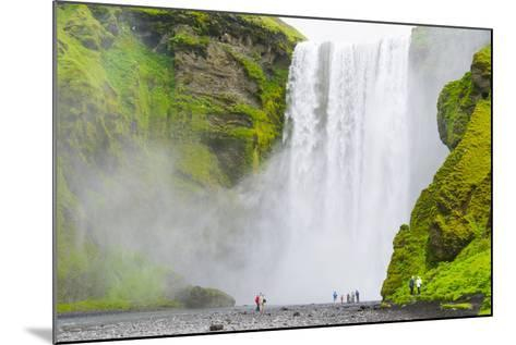 Iceland. South. Skogafoss. Hikers are Skogafoss Waterfall-Inger Hogstrom-Mounted Photographic Print