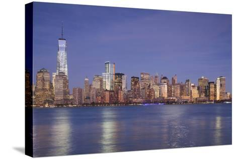 USA, New York, New York City, Lower Manhattan and Freedom Tower, Dusk-Walter Bibikow-Stretched Canvas Print