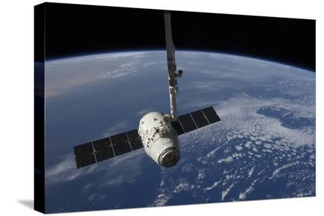 The Spacex Dragon Cargo Craft Prior to Being Released by the Canadarm2 Robotic Arm--Stretched Canvas Print