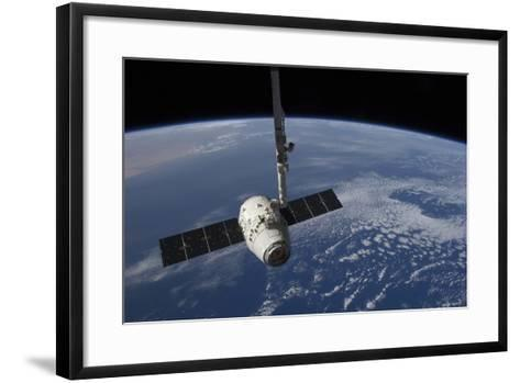 The Spacex Dragon Cargo Craft Prior to Being Released by the Canadarm2 Robotic Arm--Framed Art Print