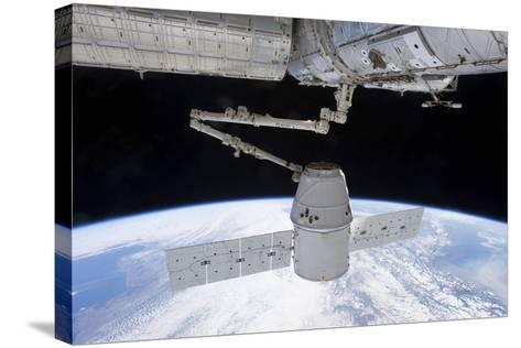Spacex Dragon During its Docking with the International Space Station--Stretched Canvas Print