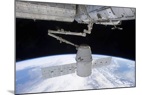Spacex Dragon During its Docking with the International Space Station--Mounted Photographic Print
