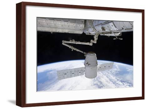 Spacex Dragon During its Docking with the International Space Station--Framed Art Print