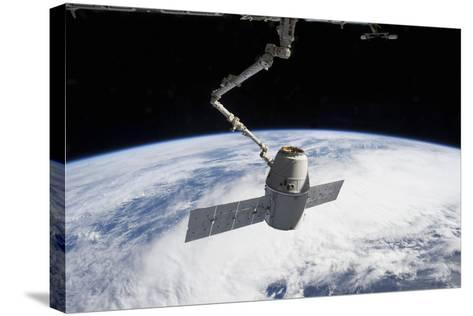 Spacex Dragon in the Grasp of Canadarm2--Stretched Canvas Print