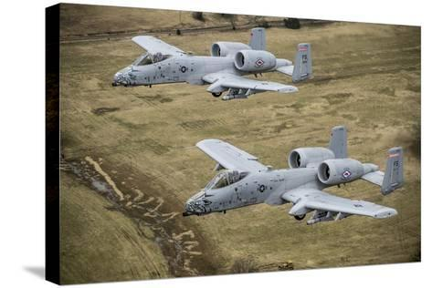 Two A-10 Thunderbolt Ii's Conduct a Training Mission over Arkansas--Stretched Canvas Print