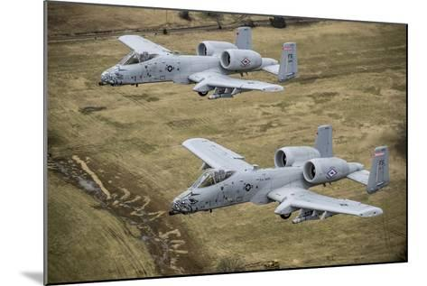 Two A-10 Thunderbolt Ii's Conduct a Training Mission over Arkansas--Mounted Photographic Print