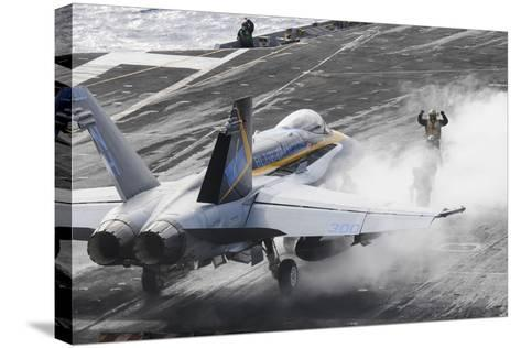 Sailors Prepare an F-A-18C Hornet to Launch from USS Nimitz--Stretched Canvas Print