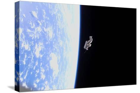 Suitsat in Orbit around Planet Earth--Stretched Canvas Print