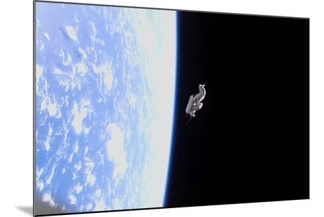 Suitsat in Orbit around Planet Earth--Mounted Photographic Print