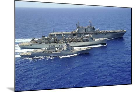 Uss Peleliu and USS Spruance Conduct a Replenishment at Sea with Usns Rainier--Mounted Photographic Print