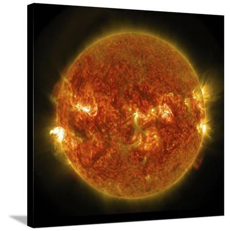 A Solar Flare Erupting on the Left Side of the Sun--Stretched Canvas Print