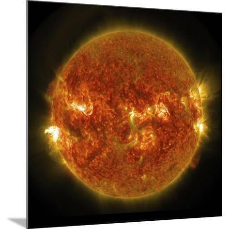 A Solar Flare Erupting on the Left Side of the Sun--Mounted Art Print