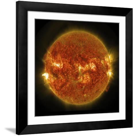 A Solar Flare Erupting on the Left Side of the Sun--Framed Art Print