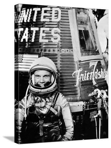 Astronaut John H. Glenn Jr. with the Mercury Friendship 7 Spacecraft--Stretched Canvas Print