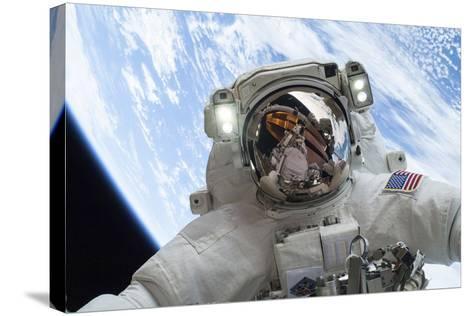 Astronaut Participates in a Spacewalk--Stretched Canvas Print