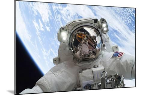 Astronaut Participates in a Spacewalk--Mounted Photographic Print