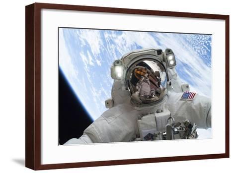 Astronaut Participates in a Spacewalk--Framed Art Print