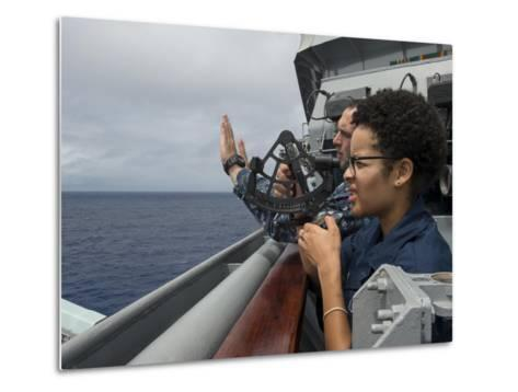 A Seaman Learns How to Operate a Sextant Aboard USS Rushmore--Metal Print