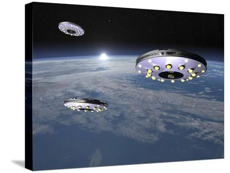 Three Ufo's Flying Above Planet Earth--Stretched Canvas Print