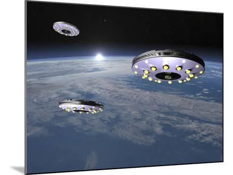 Three Ufo's Flying Above Planet Earth--Mounted Art Print