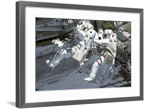 Astronauts Participate in a Spacewalk on the International Space Station--Framed Art Print