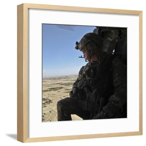 A U.S. Army Special Forces Soldier Looks Out from a Uh-60 Black Hawk--Framed Art Print