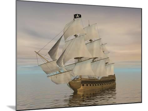 Pirate Ship with Black Jolly Roger Flag Sailing the Ocean--Mounted Art Print