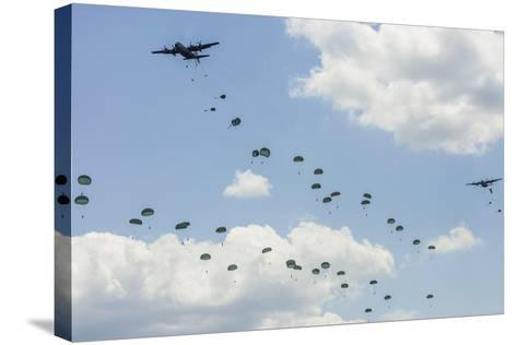 A C-130 Hercules Drop U.S. Army Airborne Troops over Maryland--Stretched Canvas Print