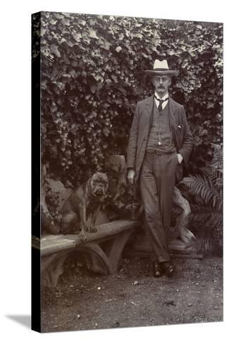 Man with a Bulldog in a Garden--Stretched Canvas Print