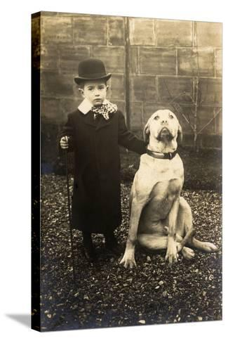 Little Boy with Large Bulldog in a Garden, France--Stretched Canvas Print