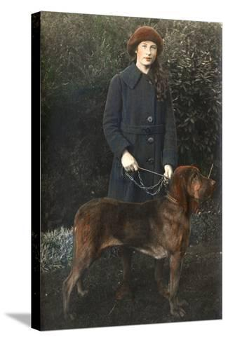 Young Woman with a Dog in a Garden--Stretched Canvas Print