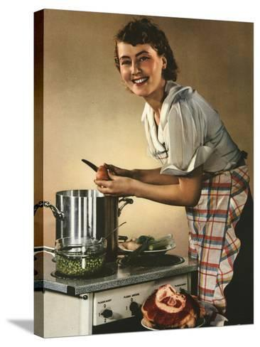 Smiling Woman Preparing a Wholesome Feast--Stretched Canvas Print