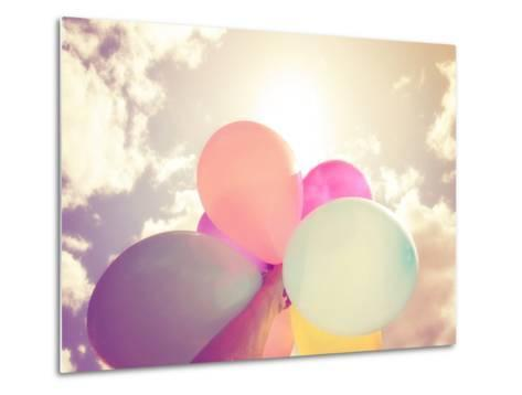 A Person Holding Multi Colored Balloons Done with a Retro Vintage Instagram Filter Effect-graphicphoto-Metal Print