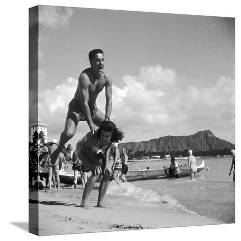 Leap-Frog Couple-Orlando-Stretched Canvas Print