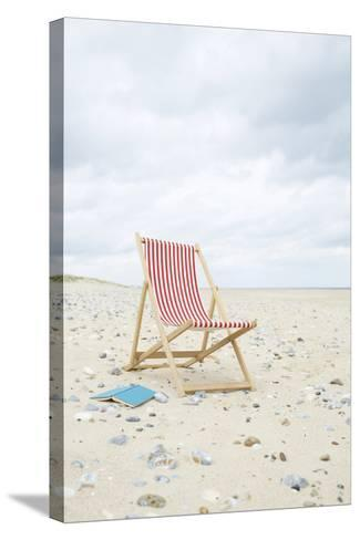 Deck Chair with Book on Sand at Beach.-Dougal Waters-Stretched Canvas Print