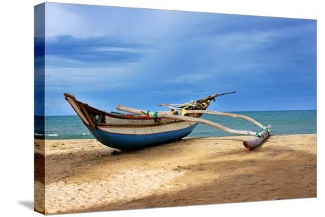 Wooden Catamaran by the Sea Shore-Juavenita Alphonsus-Stretched Canvas Print