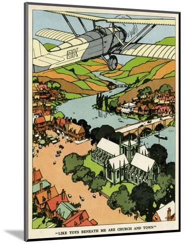 Biplane Above Church and Town--Mounted Giclee Print