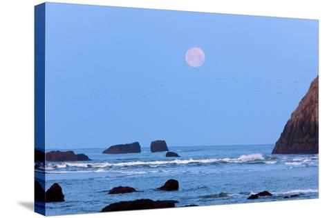 Moon Set over Rock Formations at Low Tide, Bandon Beach, Oregon, USA-Craig Tuttle-Stretched Canvas Print