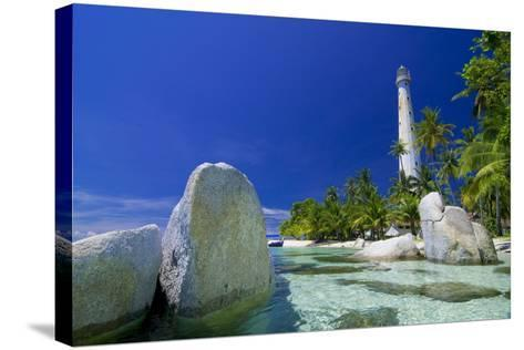 Beautiful View of an Island with White Lighthouse Fringed by Crystal Clear Sea and White Granite Bo-FADIL AZIZ-Stretched Canvas Print