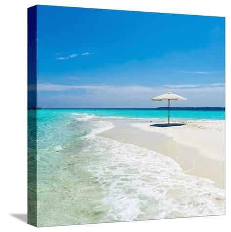 Beach Umbrella in the Maldives-John Harper-Stretched Canvas Print