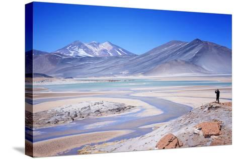 Man Standing on Rocks Looking over Miscanti Laguna, Turquoise Mineral Lake, San Pedro De Atacama-Kimberly Walker-Stretched Canvas Print