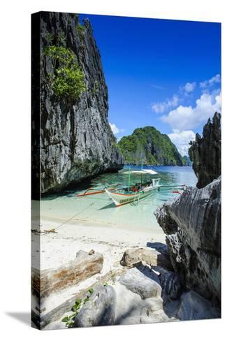 Outrigger Boat on a Little White Beach and Crystal Clear Water in the Bacuit Archipelago-Michael Runkel-Stretched Canvas Print