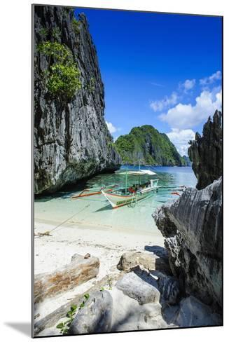 Outrigger Boat on a Little White Beach and Crystal Clear Water in the Bacuit Archipelago-Michael Runkel-Mounted Photographic Print
