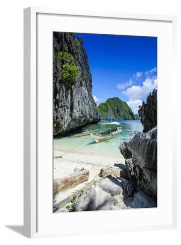 Outrigger Boat on a Little White Beach and Crystal Clear Water in the Bacuit Archipelago-Michael Runkel-Framed Art Print