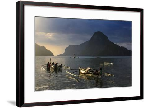 Outrigger Boat at Sunset in the Bay of El Nido, Bacuit Archipelago, Palawan, Philippines-Michael Runkel-Framed Art Print