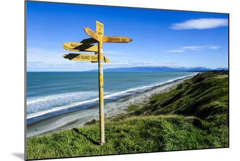 Signpost on Te Waewae Bay, Along the Road from Invercargill to Te Anau, South Island-Michael Runkel-Mounted Photographic Print