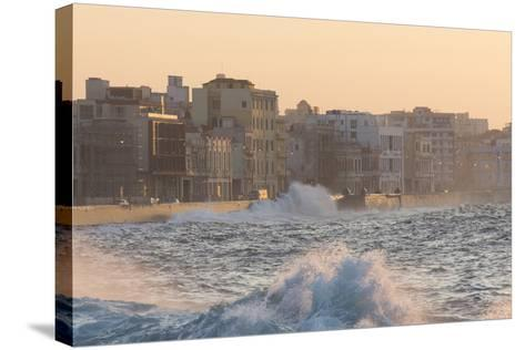 Buildings Along the Malecon in Soft Evening Sunlight with Large Waves Crashing Against the Sea Wall-Lee Frost-Stretched Canvas Print